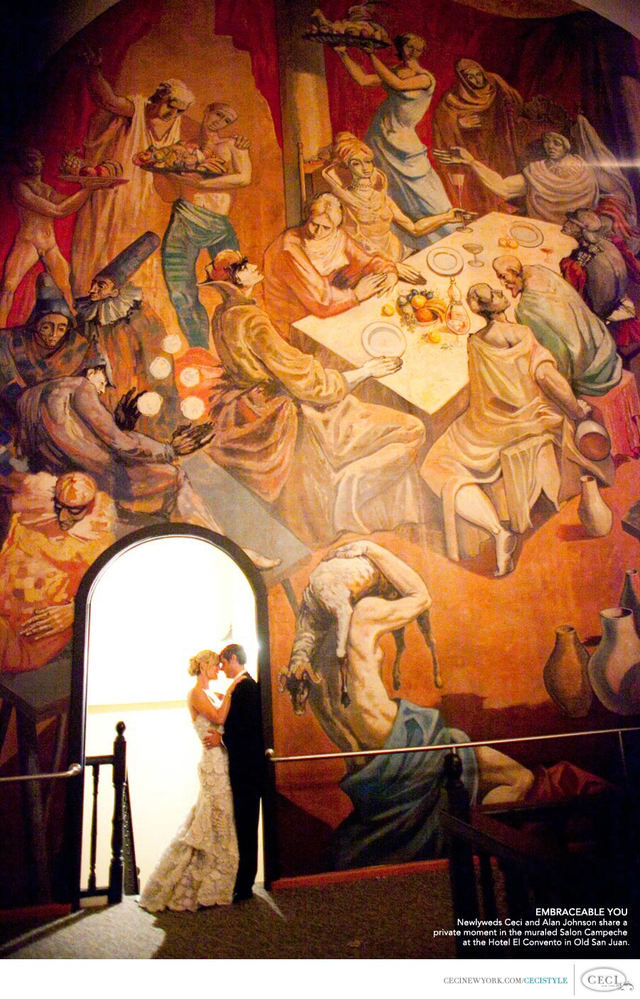Embraceable You - Newlyweds Ceci and Alan Johnson share a private moment in the muraled Salon Campeche at the Hotel El Convento in Old San Juan.