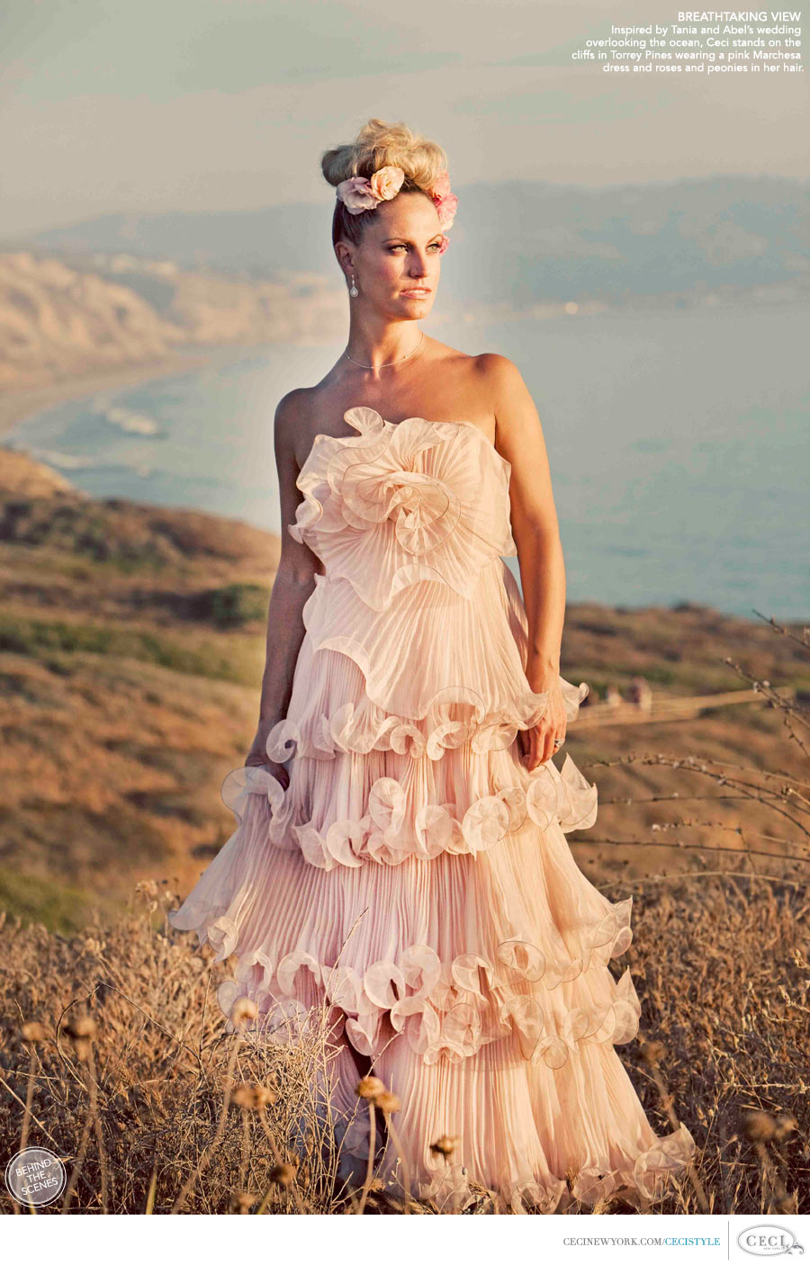 Ceci Johnson of Ceci New York - BREATHTAKING VIEW: Inspired by Tania and Abel's wedding overlooking the ocean, Ceci stands on the cliffs in Torrey Pines wearing a pink Marchesa dress and roses and peonies in her hair.