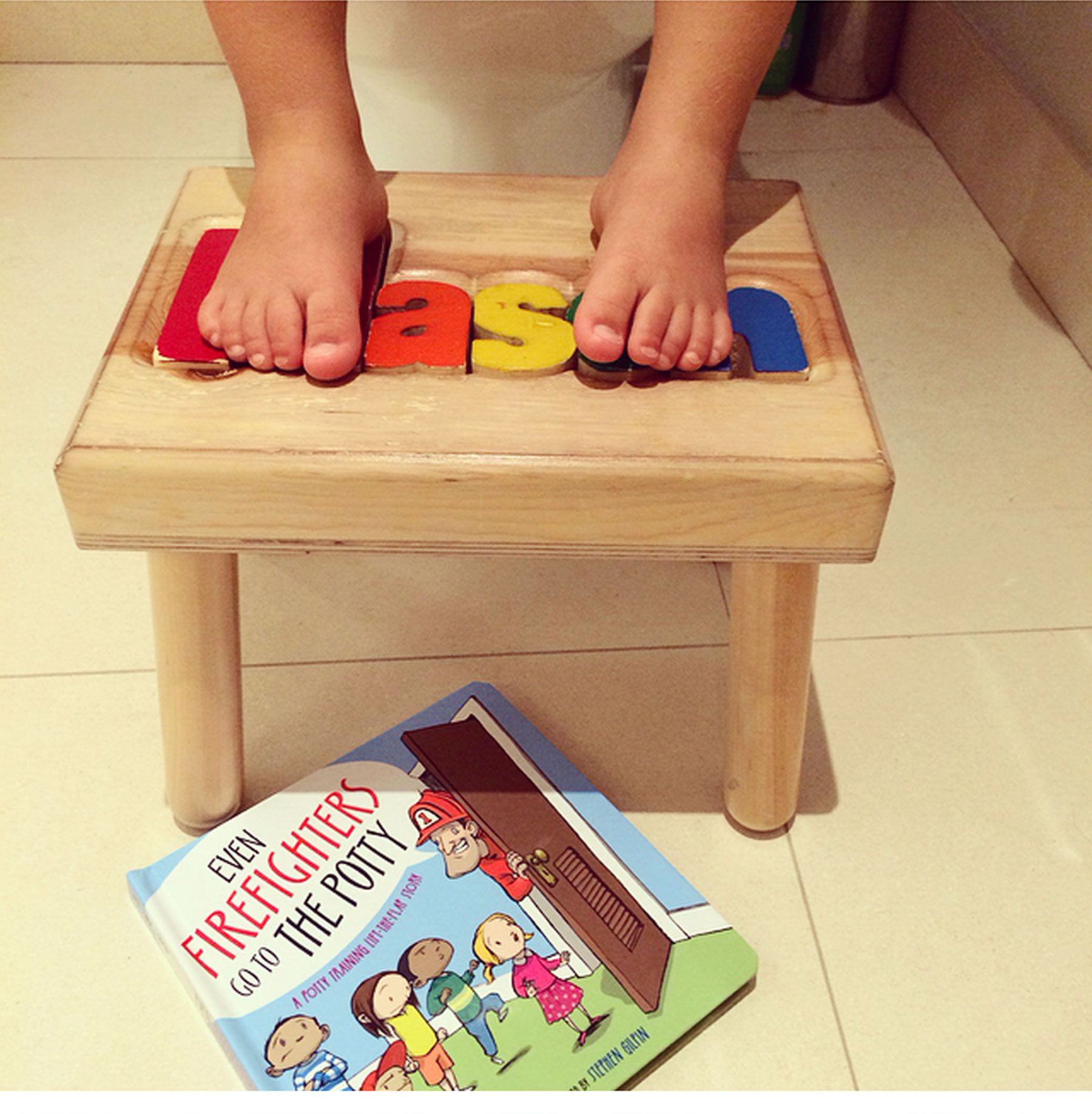 A Day in the Life of Ceci Johnson - 6:45 AM Here comes the not-so-glamourous part of the day. Having a toddler means morning potty training! I'm in full mom mode reading him the book 'Even Firefighters Go to the Potty' and coaching him along.