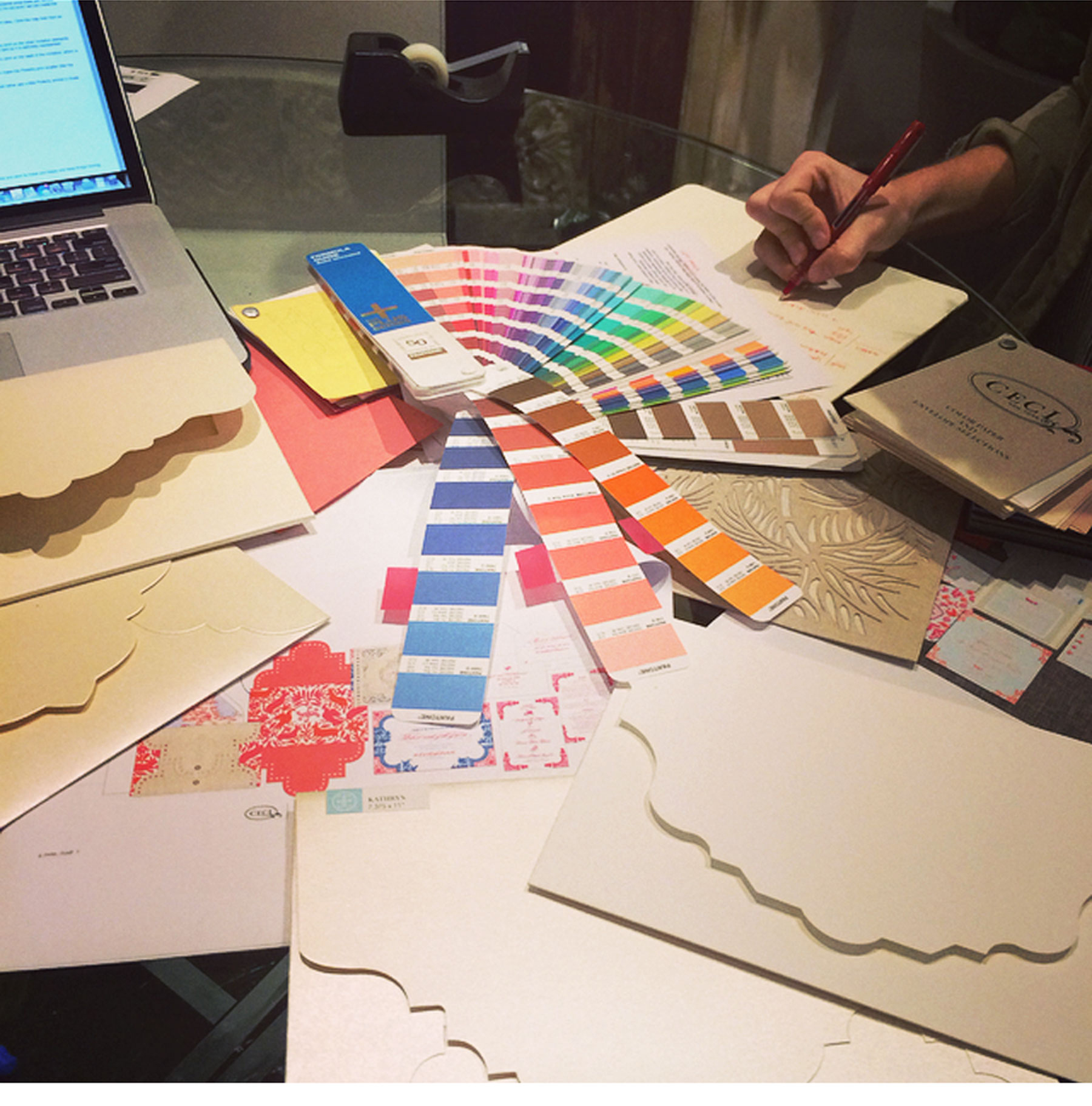 A Day in the Life of Ceci Johnson - 3:30 PM Design meeting. I sit down with my team to flesh out all the possibilities including Pantone colors, style and envelopes to make sure our client sees the best options.