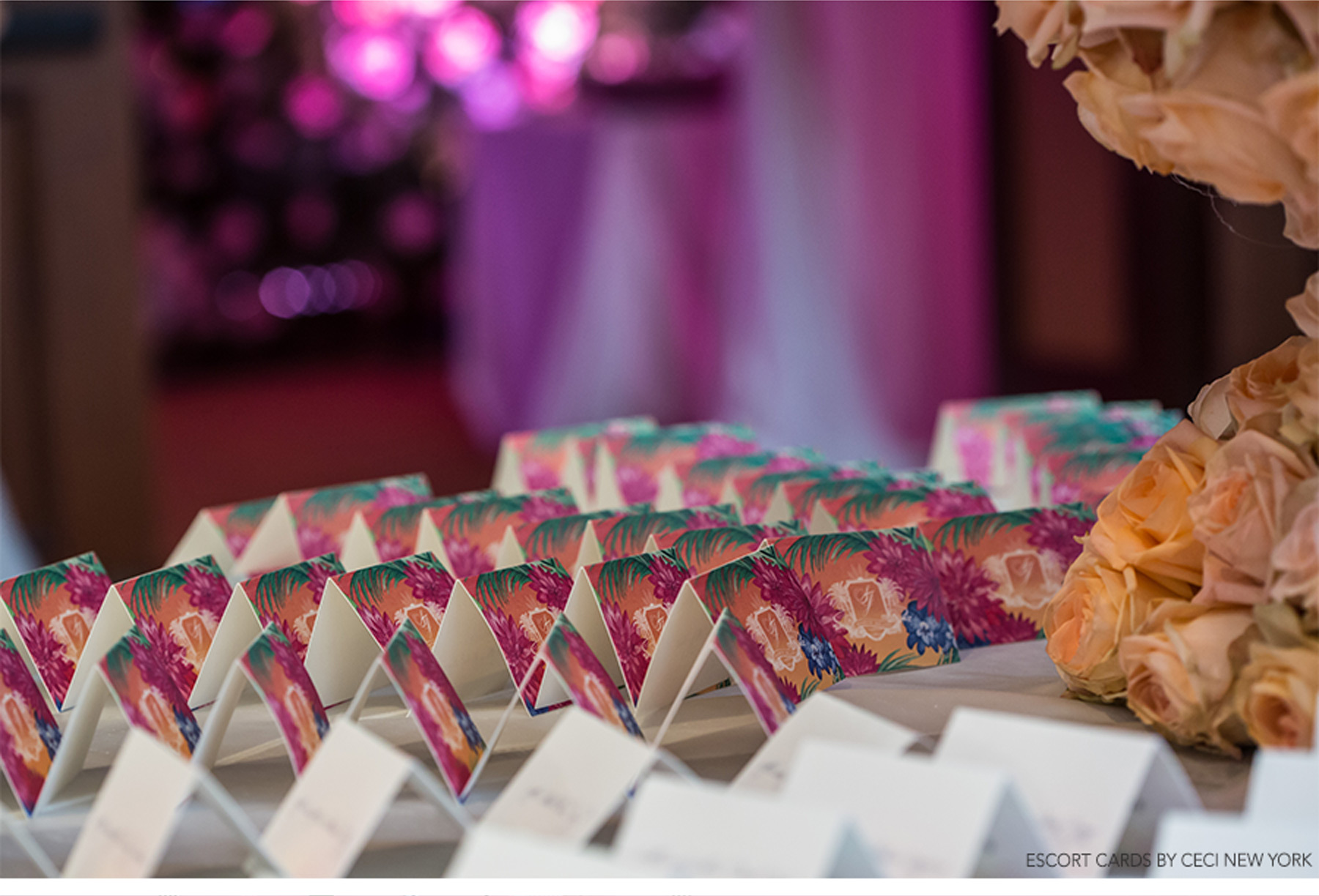 Our Muse - Sunny, Tropical Wedding in Florida - Be inspired by Sally & Javier's vibrant, tropical wedding in Florida - tropical wedding, wedding inspiration, colorful, florida wedding, ceci new york, escort cards, table signs, watercolor, colorful, palm trees, flowers, centerpieces, cake, pink, purple, bride, groom, custom